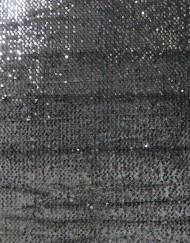 Tela martele negro lentejuelas.