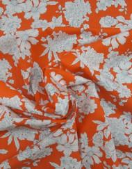 Tela popelín estampado floral fondo naranja